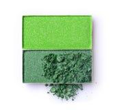 绿化构成的被击碎的眼影膏作为化妆产品样品  免版税图库摄影