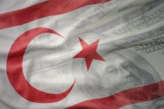 北塞浦路斯的五颜六色的挥动的国旗美国美元金钱背景的 免版税库存图片