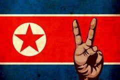 北朝鲜的老难看的东西旗子 军械士 战争 危险 扶手 导弹 世界和平和平主义 免版税库存照片