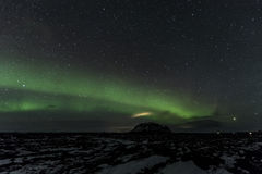 北极光上面登上Búrfell冰岛 库存照片