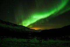 北极光在瑞典森林里 免版税库存图片