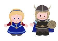 北欧海盗、男人和妇女古老斯堪的纳维亚衣物的 库存照片