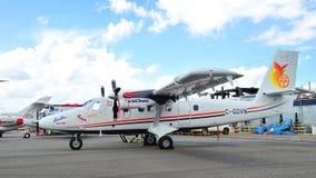北欧海盗空气DHC-6孪生水獭系列在显示的400个涡轮螺旋桨发动机南极可胜任的航空器在新加坡Airshow 2012年 免版税图库摄影