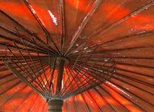 北泰国样式老红色伞 库存照片
