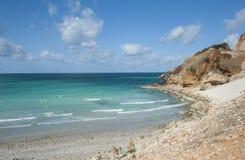 从北海岸的亚丁湾,海滩 免版税库存照片