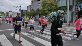 北海道Sapporro日本2017年8月从会集在国际事件的世界的马拉松运动员第20  免版税库存照片