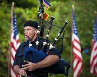 匹兹堡警察鲜绿色社团吹笛者 免版税库存照片