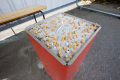 区抽烟的工作 免版税库存图片