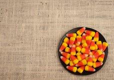 区粗麻布糖味玉米盘字 免版税库存照片
