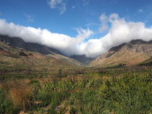 区美丽的高涨山理想的风景雪靴 免版税库存照片