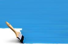 区蓝色油漆刷绘画 免版税库存照片