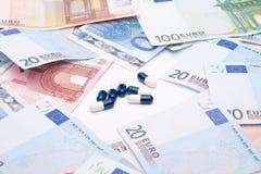 医学和货币 图库摄影