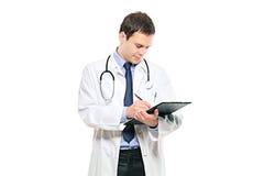 医生下来男注意文字年轻人 免版税库存照片