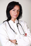 医生医疗微笑的妇女 免版税库存照片