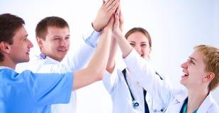 医生和护士堆积手的一个医疗队的 免版税库存照片
