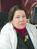 医生女性她的办公室 库存照片
