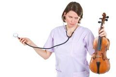 医生女性藏品听诊器小提琴 库存照片