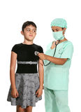 医生孩子使用 免版税库存图片