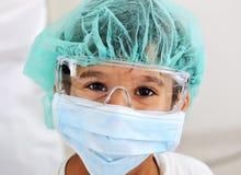 医生孩子屏蔽 免版税图库摄影