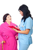 医生对妇女的长辈规定写道 图库摄影