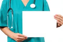 医生拿着白板 概念谎言医学货币集合听诊器 库存照片