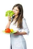 医生新鲜的愉快的蔬菜 免版税图库摄影