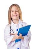 医生服装的女孩 免版税库存照片