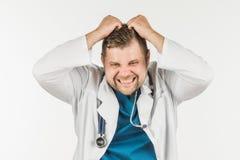 医生犯了一个错误,当工作时 医生是在pani 免版税库存照片