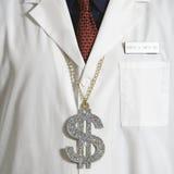 医生美元的符号佩带 库存照片