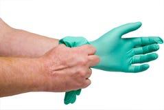 医疗自由手套的乳汁 免版税库存照片