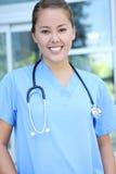 医院医疗护士成功的妇女 免版税图库摄影
