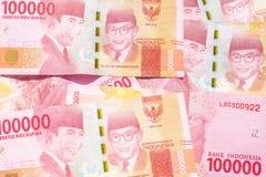 十万卢比印度尼西亚纸币背景 库存图片