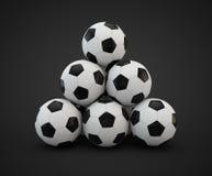 十个足球面对金字塔 免版税库存照片