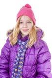 十几岁的女孩在白色backgroung的冬天成套装备摆在 免版税库存图片