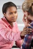 十几岁的女孩拜访Office Suffering With Depression医生的 库存图片