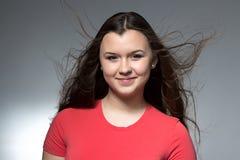十几岁的女孩照片有流动的头发的 库存图片