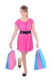 十几岁的女孩纵向有购物袋的在白色 库存图片