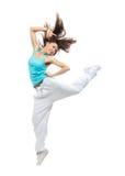 十几岁的女孩跳的跳舞 免版税库存图片