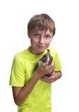 十几岁的男孩用在她的胳膊的一只兔子 隔绝在白色backgro 免版税库存照片