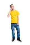 十几岁的男孩谈话在电话 库存照片