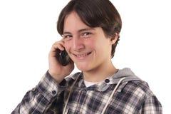 十几岁的男孩谈话在移动电话 免版税库存照片