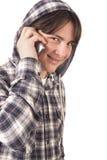十几岁的男孩谈话在移动电话 免版税图库摄影