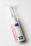 10十欧元在电灯泡的管形状 免版税库存图片