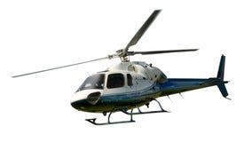 直升机在飞行中被隔绝反对白色 库存照片