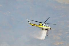 直升机水下落 图库摄影