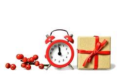 午夜时钟和在白色隔绝的礼物盒 库存照片
