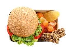 午餐盒用在白色背景,顶视图的开胃食物 免版税库存图片