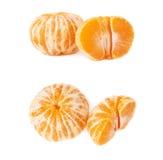 半和整个新鲜的水多的蜜桔果子被隔绝在白色背景 免版税库存图片