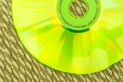 半在日本席子安置的绿色CD 免版税图库摄影