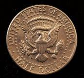 半硬币的美元 免版税库存图片
